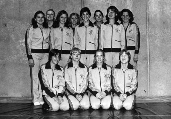 Black and white photo of the 1979 University of Oregon women's gymnastics team taken in the Gerlinger Annex gym. From left to right, front row: Gail Bruner, Sharron Blanchard, Gloria Shepherd, unidentified. Back row: Cindi Gleason, Patti Thompson, Darla Jones, Teri Larson, Barbara Andrews, Joan Cameron, Sara Gustafson, unidentified. ©University of Oregon Libraries - Special Collections and University Archives