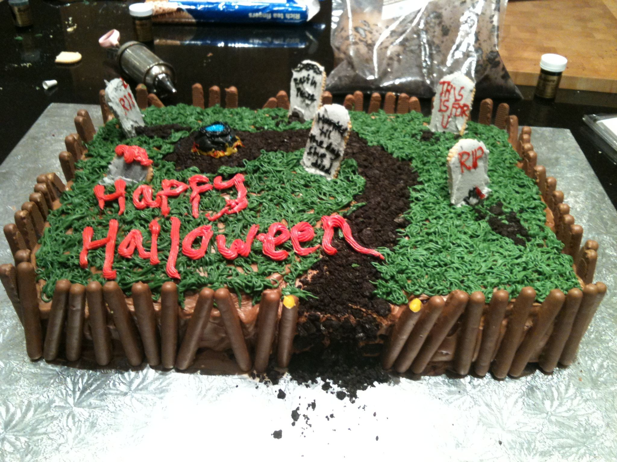 Halloween graveyard cake I made for a party. The dirt is ...