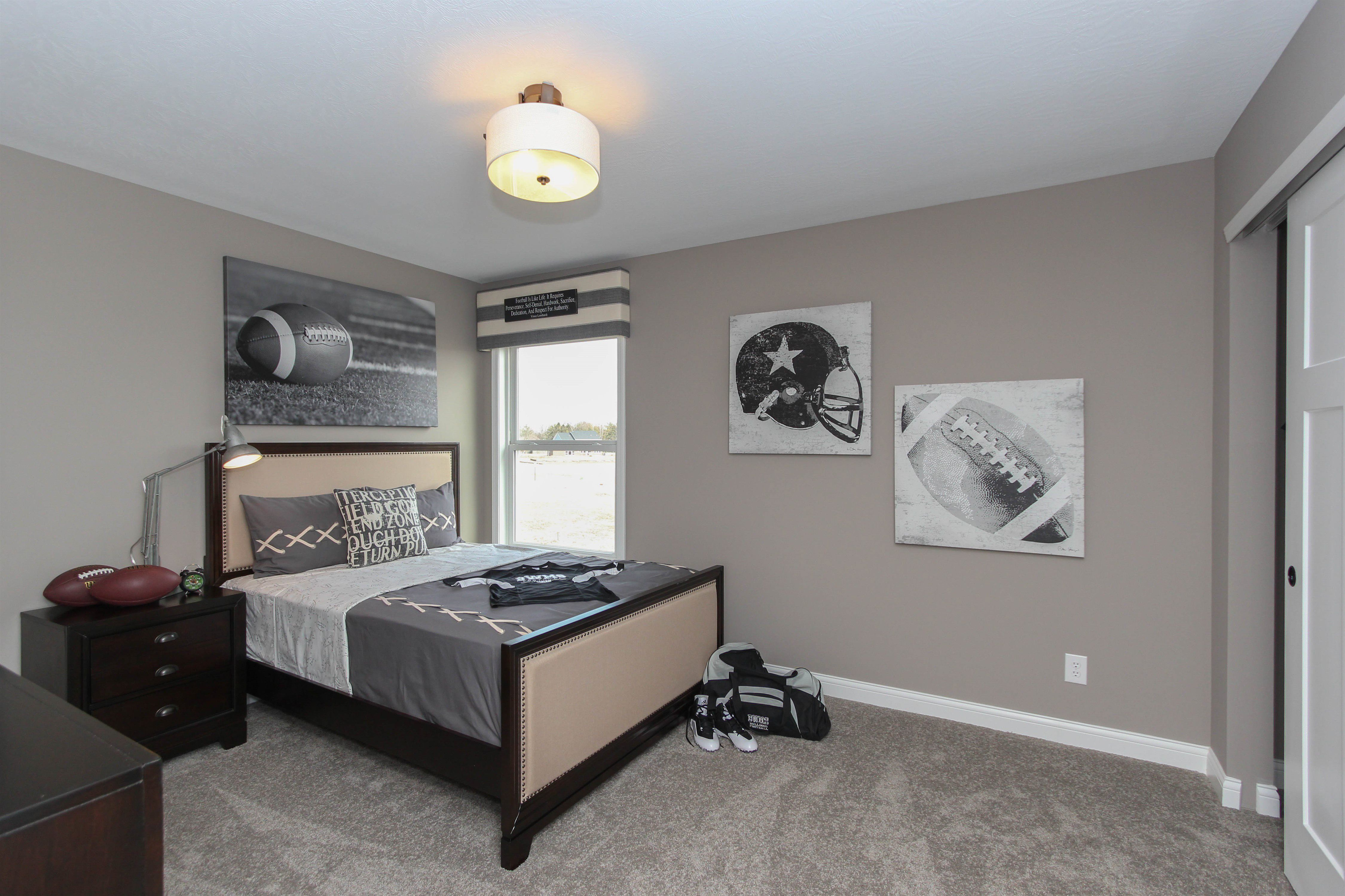 This Football Themed Kidu0027s Bedroom Is Classy And Comfortable. Seen In The  Morris At The