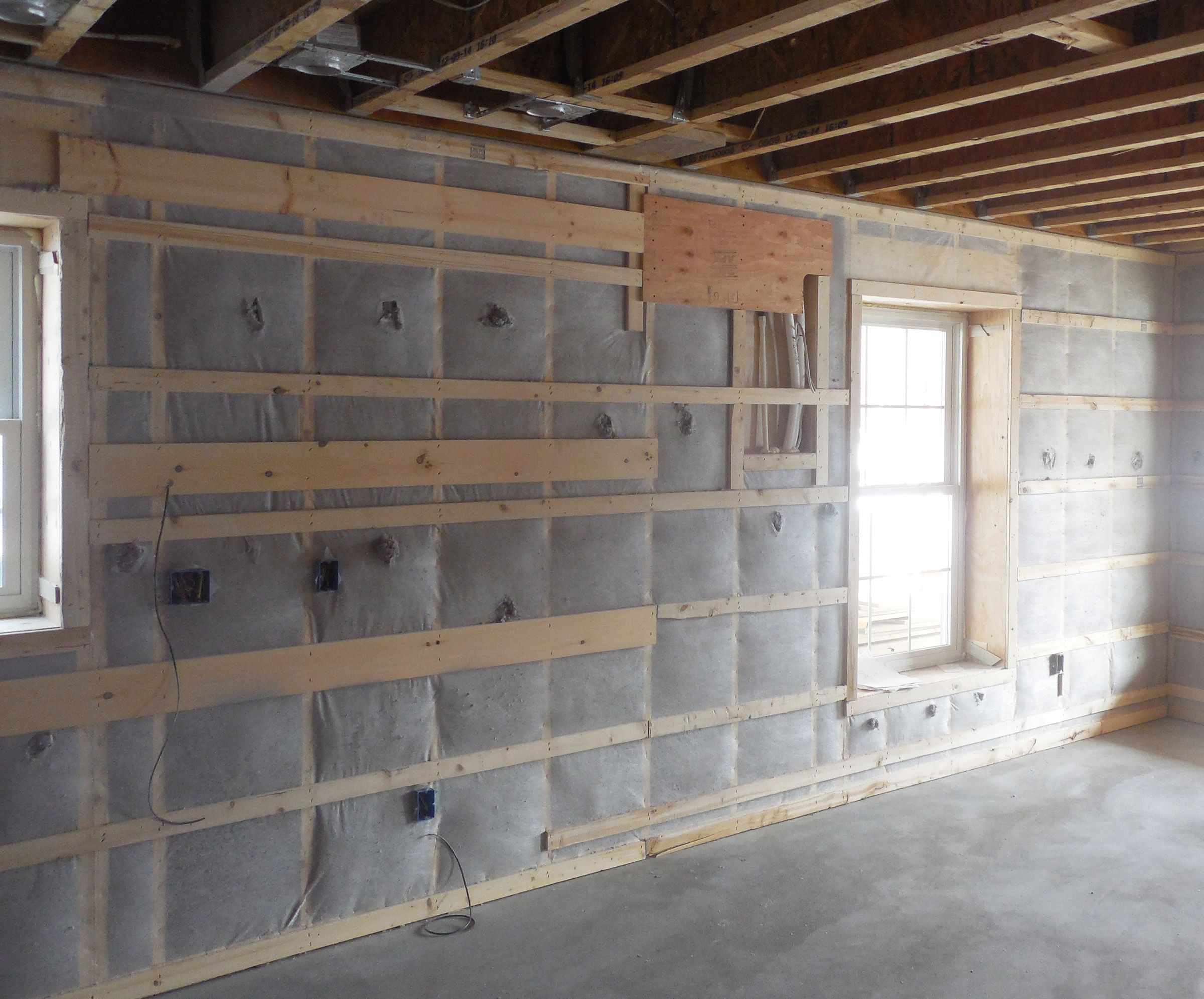 Double Wall Construction Building : The double stud walls were insulated with dense packed