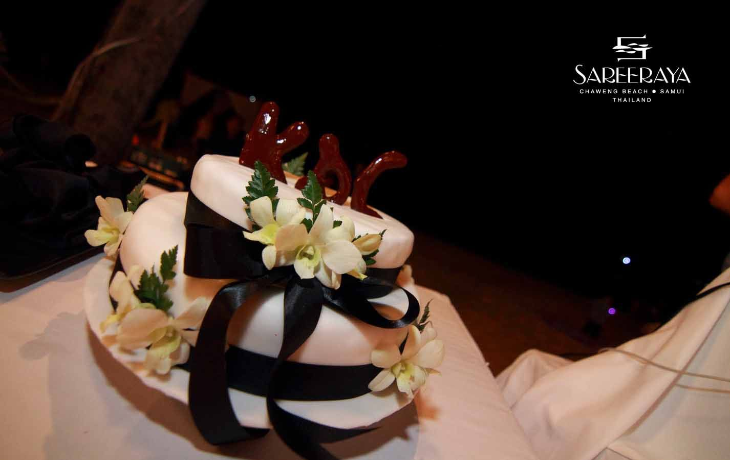 Who Doesn't Love Chocolate! Chocolate Cake with Black Ribbon and Chocolate Initials of Bride & Groom.