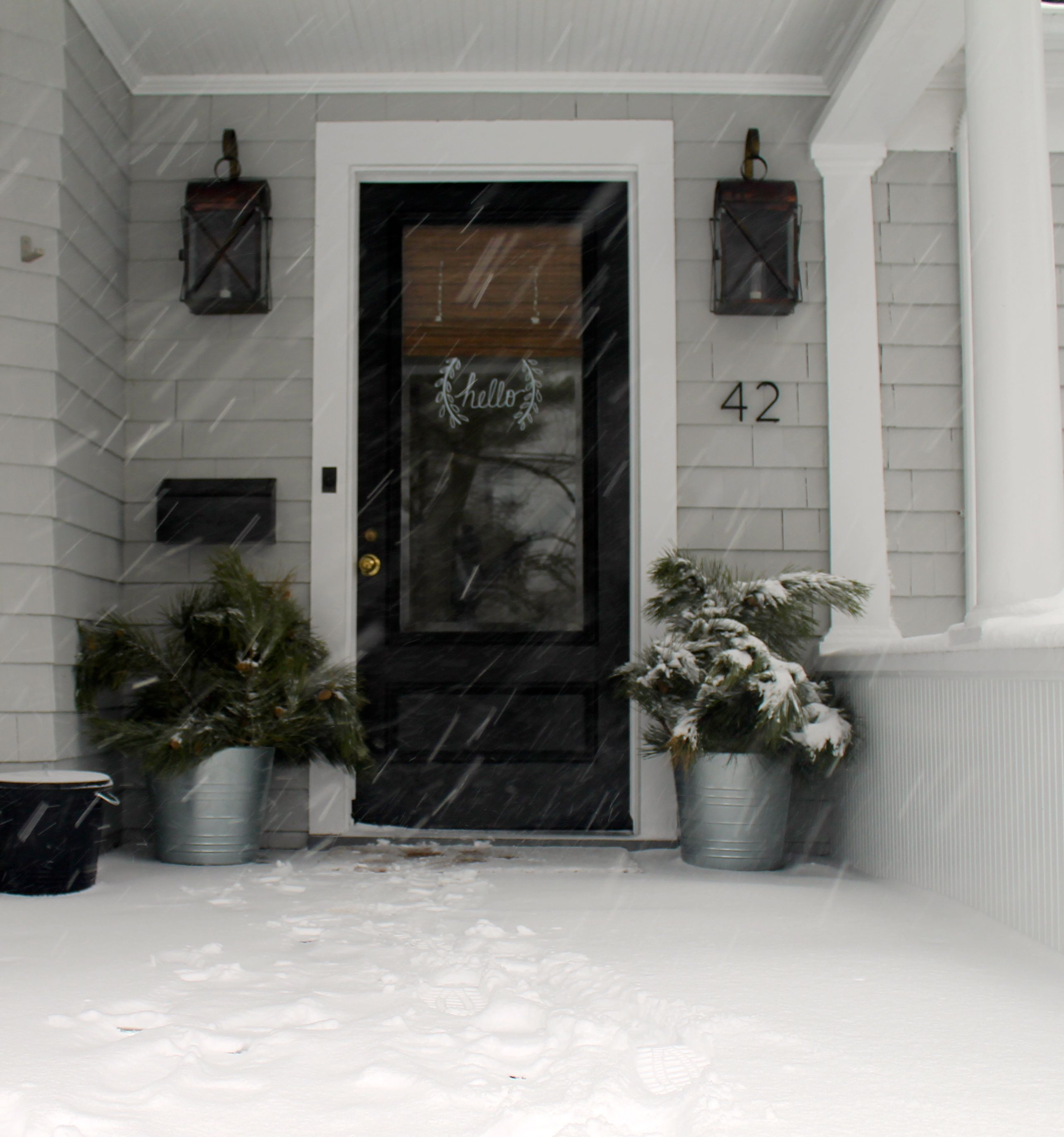 Hello snow glass storm doors storm doors and stenciling for Front door with storm door