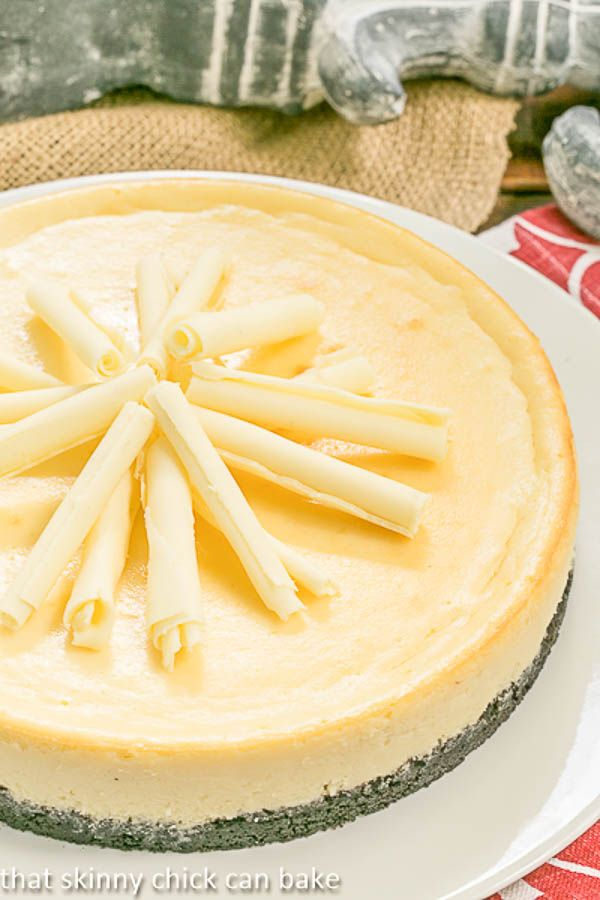 White Chocolate Frangelico Cheesecake | A luscious cheesecake with a chocolate cookie crust, white chocolate and a slosh of Frangelico