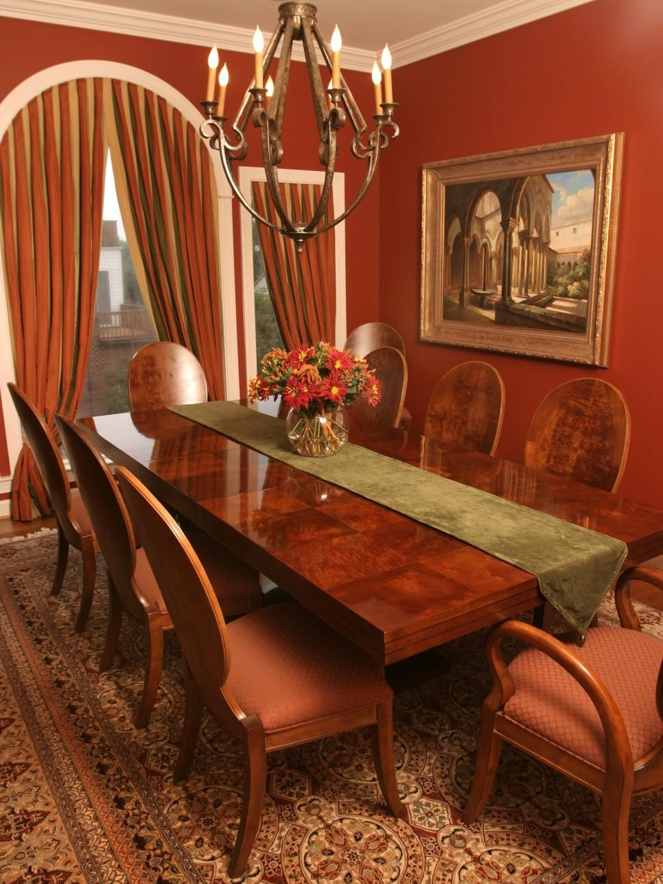 This Transitional Dining Room Is Painted In A Brick Red To Impressive Red Dining Rooms Decorating Inspiration