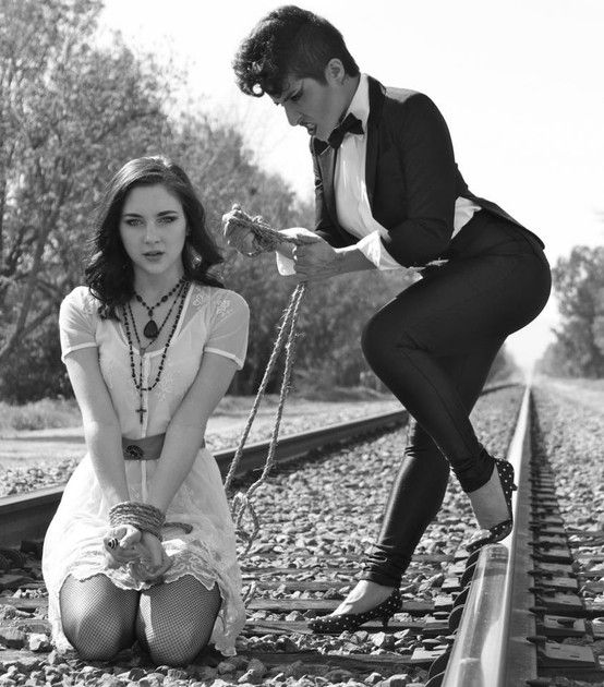 Naughty girl. Photo: Jamie Blank Models: Natalya Oliver, Haley Ramm bound, tied  up, black and white, suit and tie, bowtie, rail road, damsel in distress,  ...