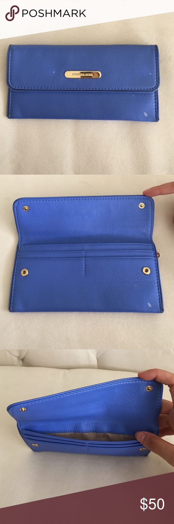 Michael Kors Slim Wallet (price negotiable) overall in good condition considering use , only imperfections are as seen in the photo which is on the front of the wallet but nothing major and this wallet is very easy to carry around and light and beautiful color Michael Kors Bags Wallets