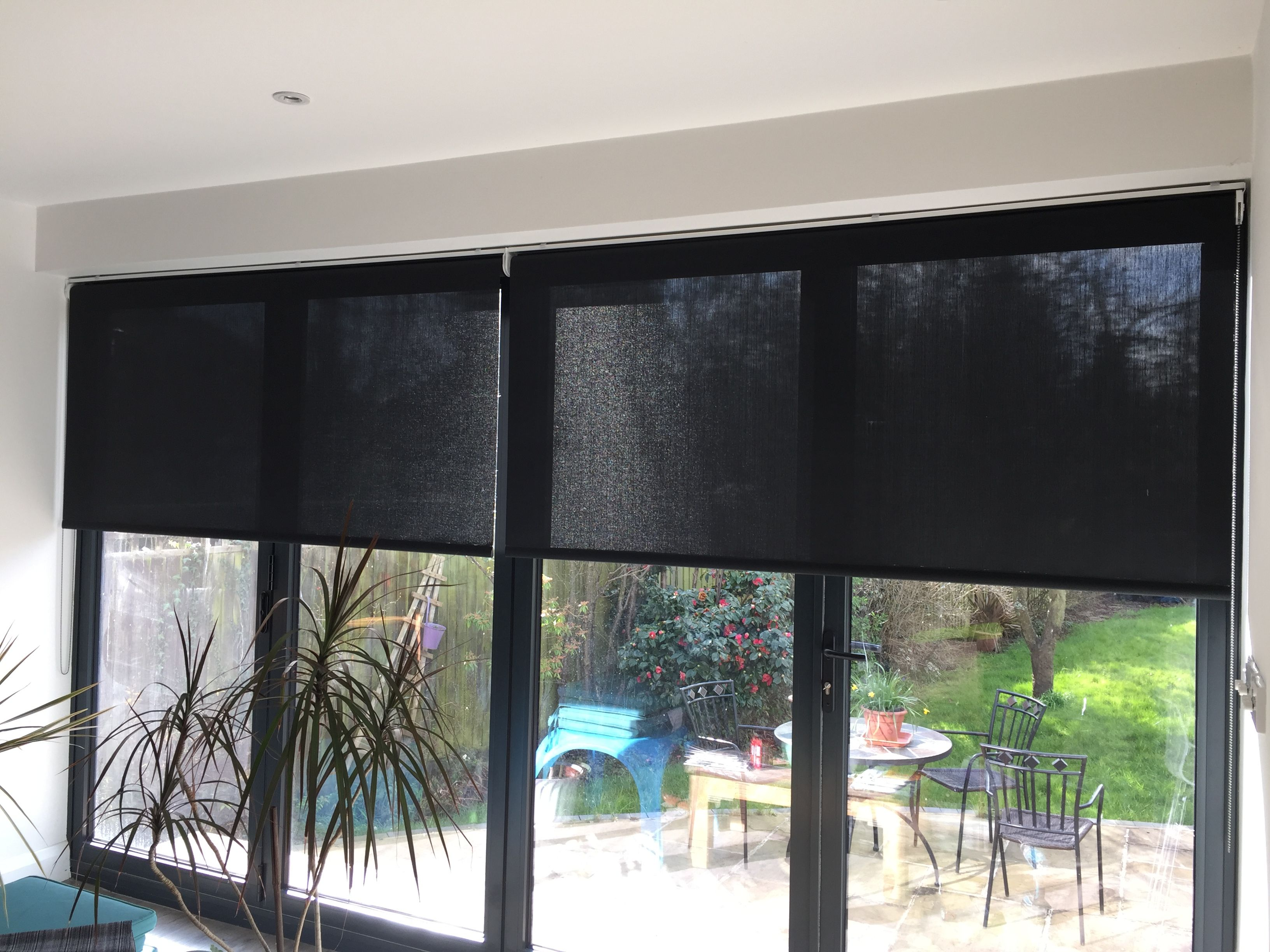 Roller Blinds In Sunscreen Fabric On Bifold Doors Window