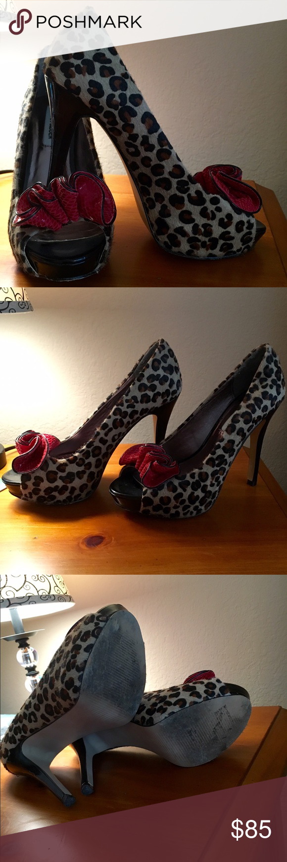 Steve Madden Leopard Print Heels with Red Bow Gorgeous Steve Madden Leopard print peep toe heels with red leather bows.  These are so adorable and make an amazing statement! Good condition! Bottoms have some wear (can be seen in pictures).  The Metallic inside is starting to peel where the ball of your foot goes but could easily be glued back into place.  They are a size 6. OBO Steve Madden Shoes Heels