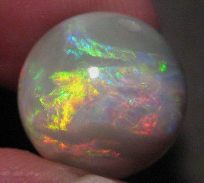 Australian Mintabie Semi Black Opal Focal Bead.  Selling now.  Click on the link to go through to our store.