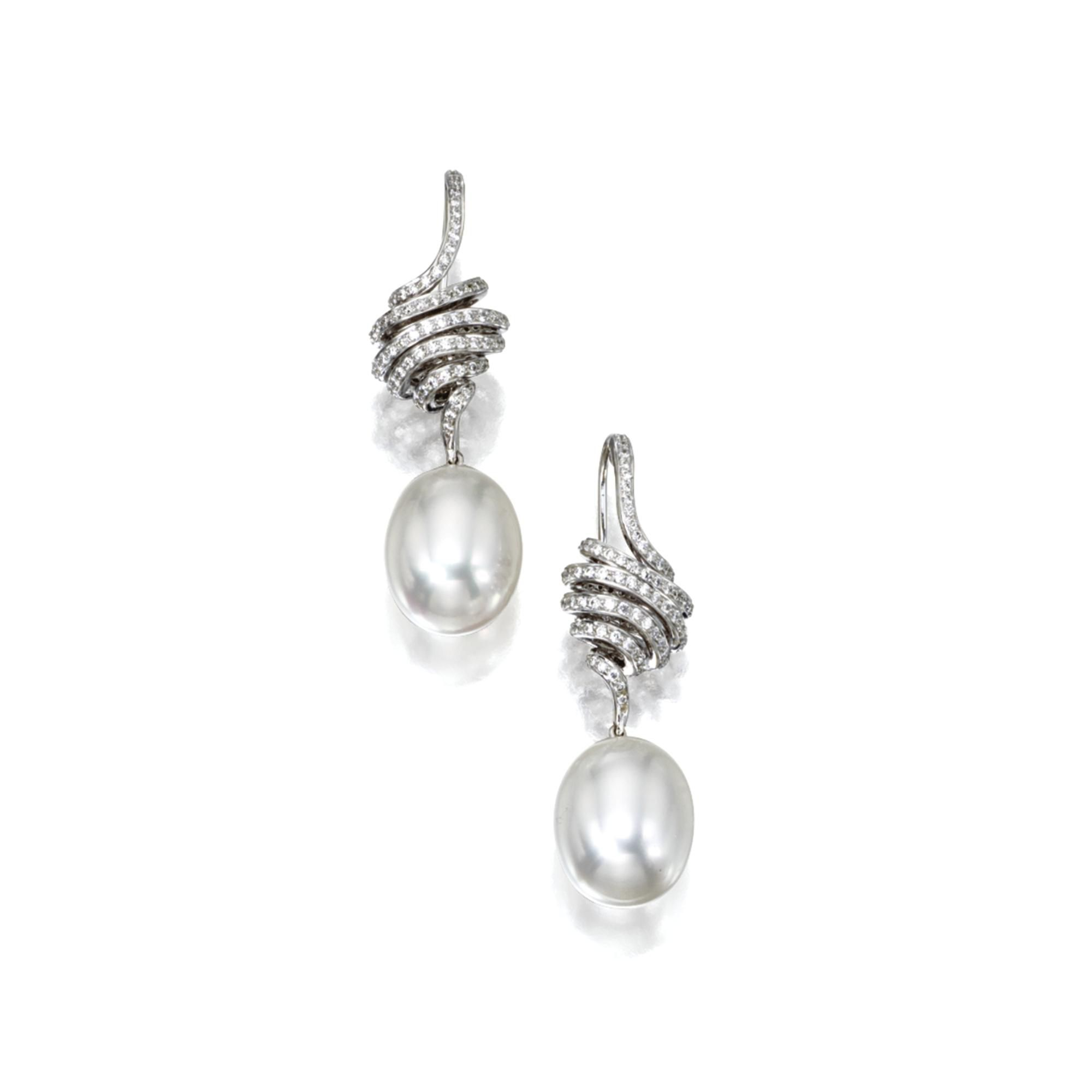 PAIR OF CULTURED PEARL AND DIAMOND EARRINGS The 2 cultured pearl drops measuring…