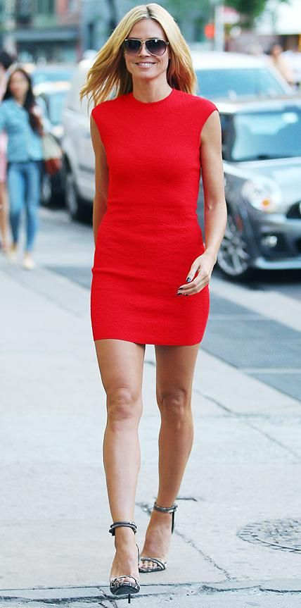 Heidi Klum is red hot in clinging minidress which displays her toned pins.