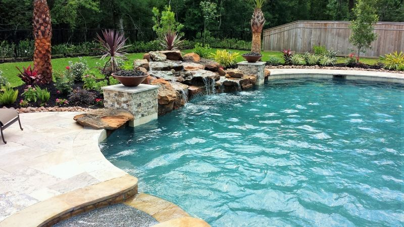 Katy Water Features Photos Houston Waterfalls Raised Spas Stacked Stone Columns With Fire Bowls Framing A Pool Water Features Pool Custom Inground Pools