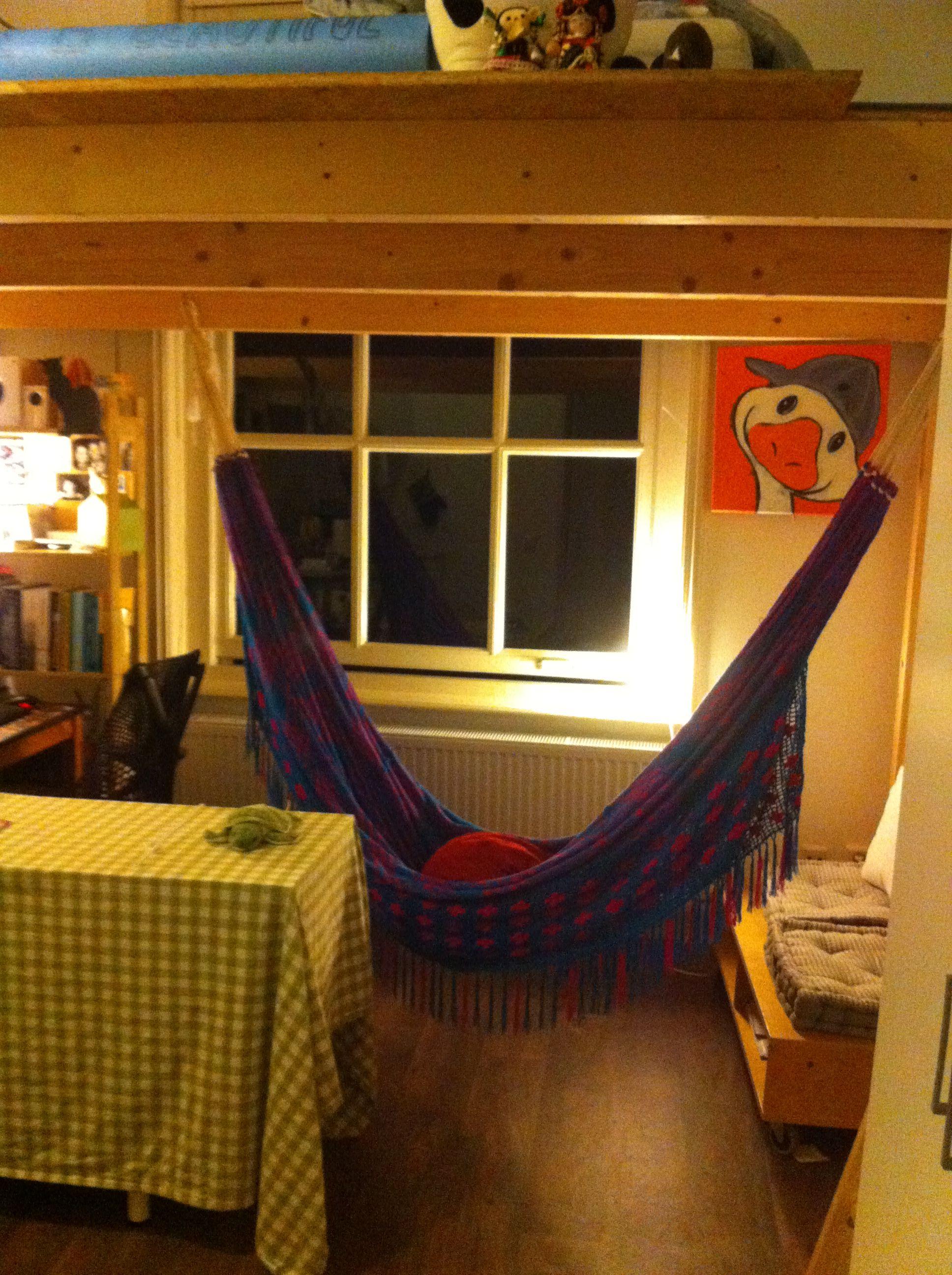 Loftbed and wayuu hammock in small studio for the room