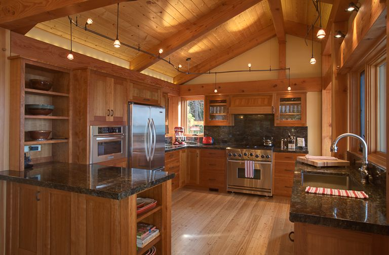 The kitchen is outfitted with stainless steel appliances, fir ...