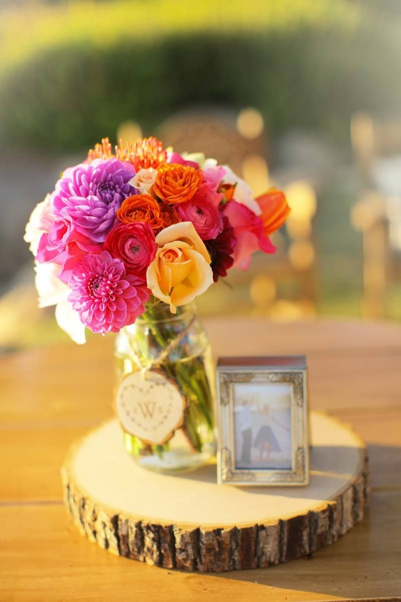 Flowers and initial decor on mason jars