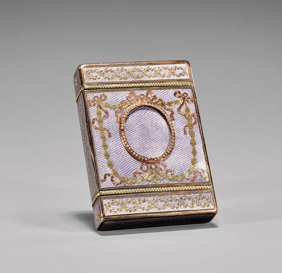 AN ANTIQUE RUSSIAN GUILLOCHE ENAMEL CIGARETTE CASE. The rectangular form mounted in rose and yellow gold floral and ribboned swags, a blank seed pearl framed reserve to the front of the main compartment, with one side opening to reveal a striker.