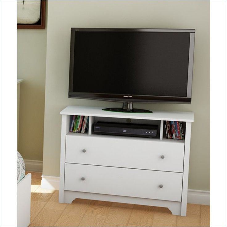 Small, Narrow TV Stand Flanked By Bookcases