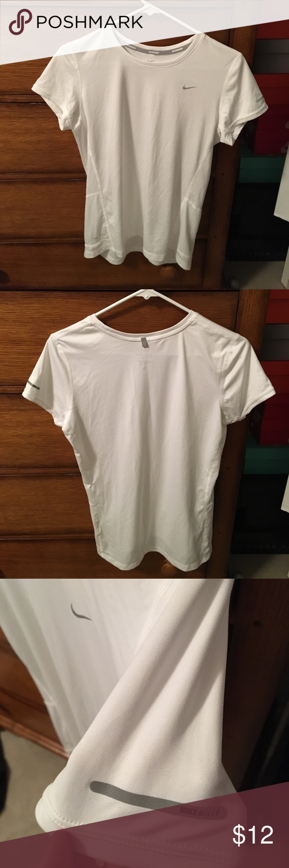 Nike dry-fit tee Lightly used Nike dry-fit athletic tee. Still looks shiny white. 100% recycled polyester. Happy poshing😋👍 Nike Shirts Tees - Short Sleeve
