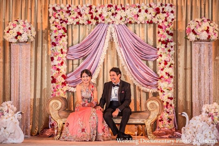 An indian bride and groom at their classy reception for Background decoration for indian wedding