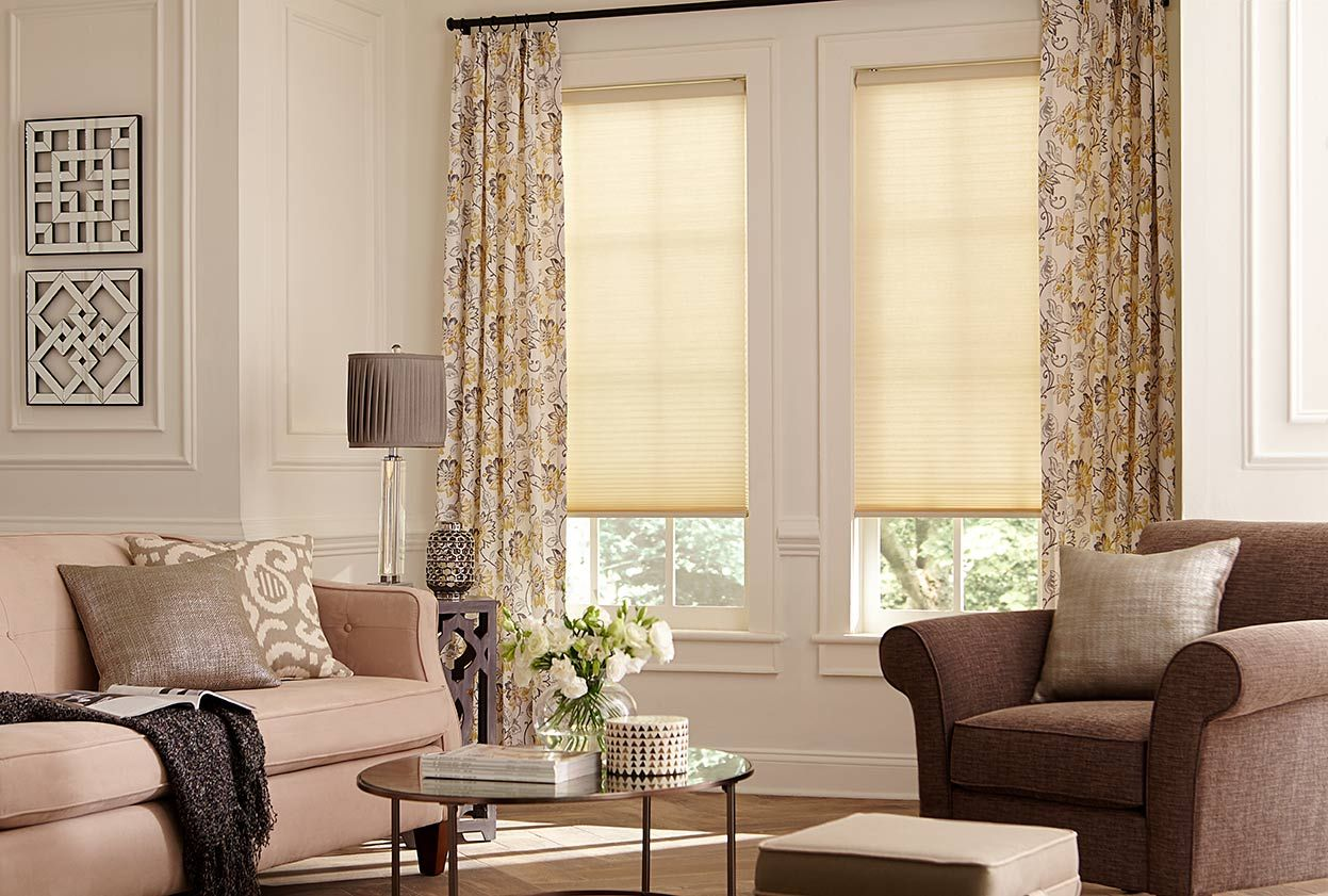 Give windows a layered look (and extra insulation!) with cellular shades in a solid color to match your drapes.