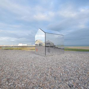 A Mirrored Hut on the Beach Piques Curiosity