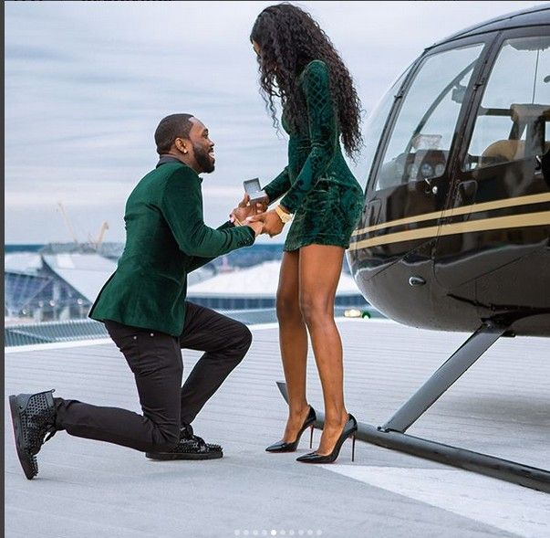 Man Proposes To His Girlfriend Beside A Helicopter. Photos