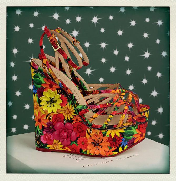 Go crazy for colour with Meredith. This vivacious wedge is dressed in an eye-catching crepe de chine floral pattern with the mischievous Frida Kahlo peeking between its petals.