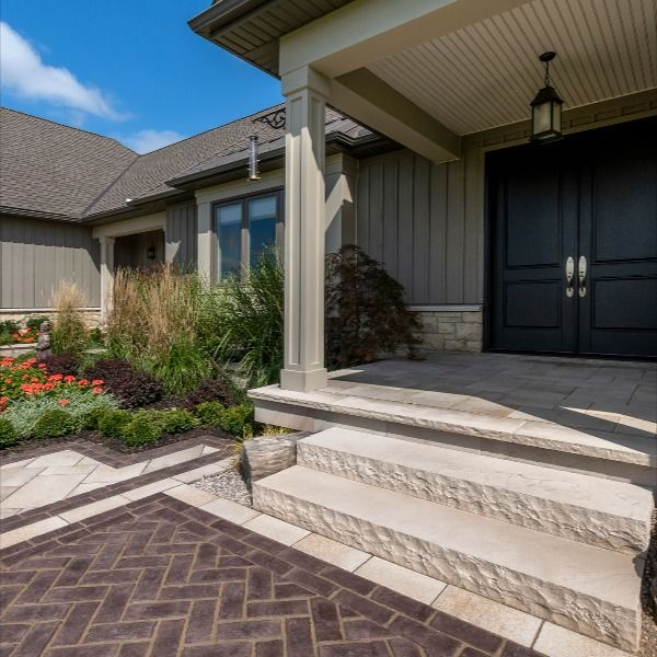 This front entrance makes a lasting impression to visiting guests. The contrasting colors of Summer Wheat (in Umbriano) and 3 Color Blend (in Copthorne) are a unique and unforgettable combination. #CurbAppeal #FrontEntrance #Umbriano #Copthorne