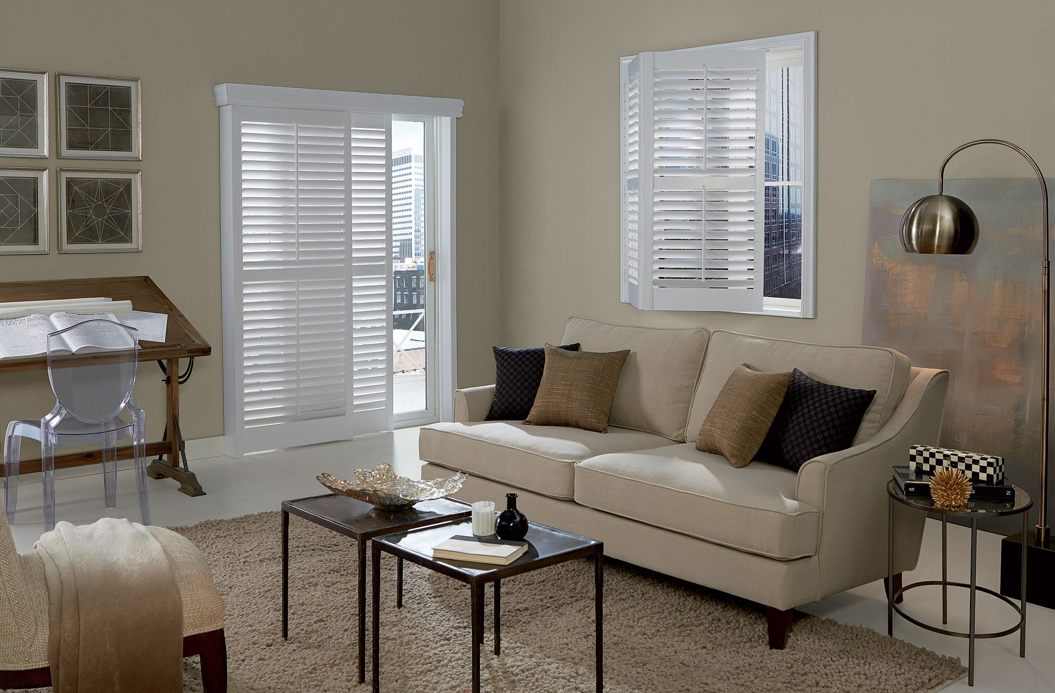 Wood bypass and bi-fold shutters with a decorative #valance in white.