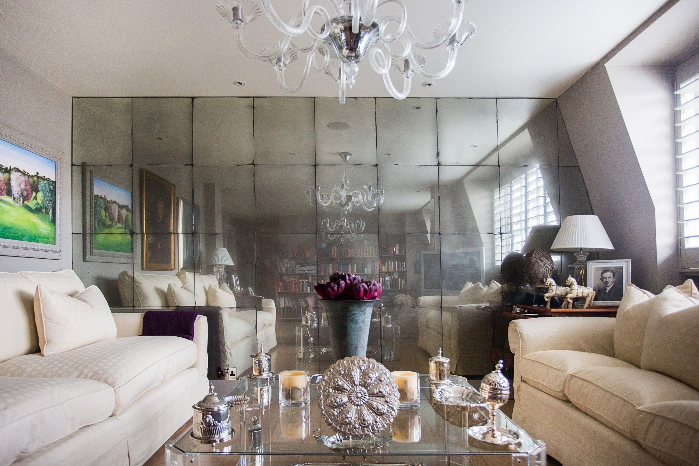 Living Room Feature Wall Clad In Antiqued Mirror Glass Panels