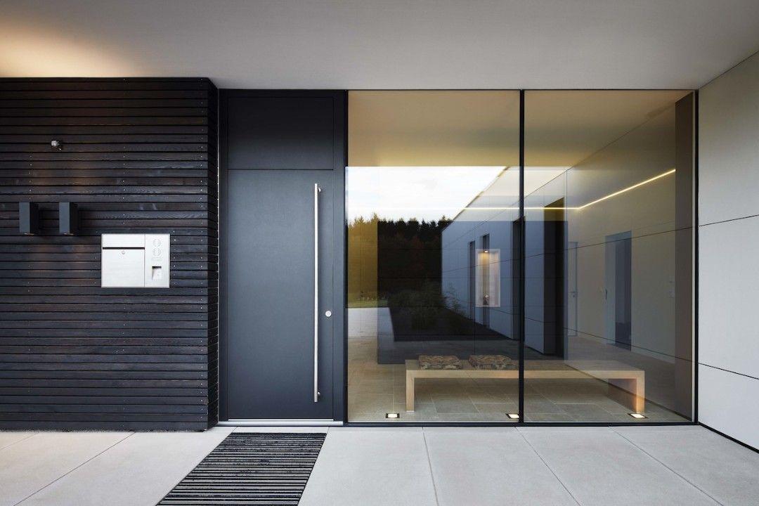 eleganter eingangsbereich mit bodentiefen fenstern - Moderner Eingangsbereich Aussen