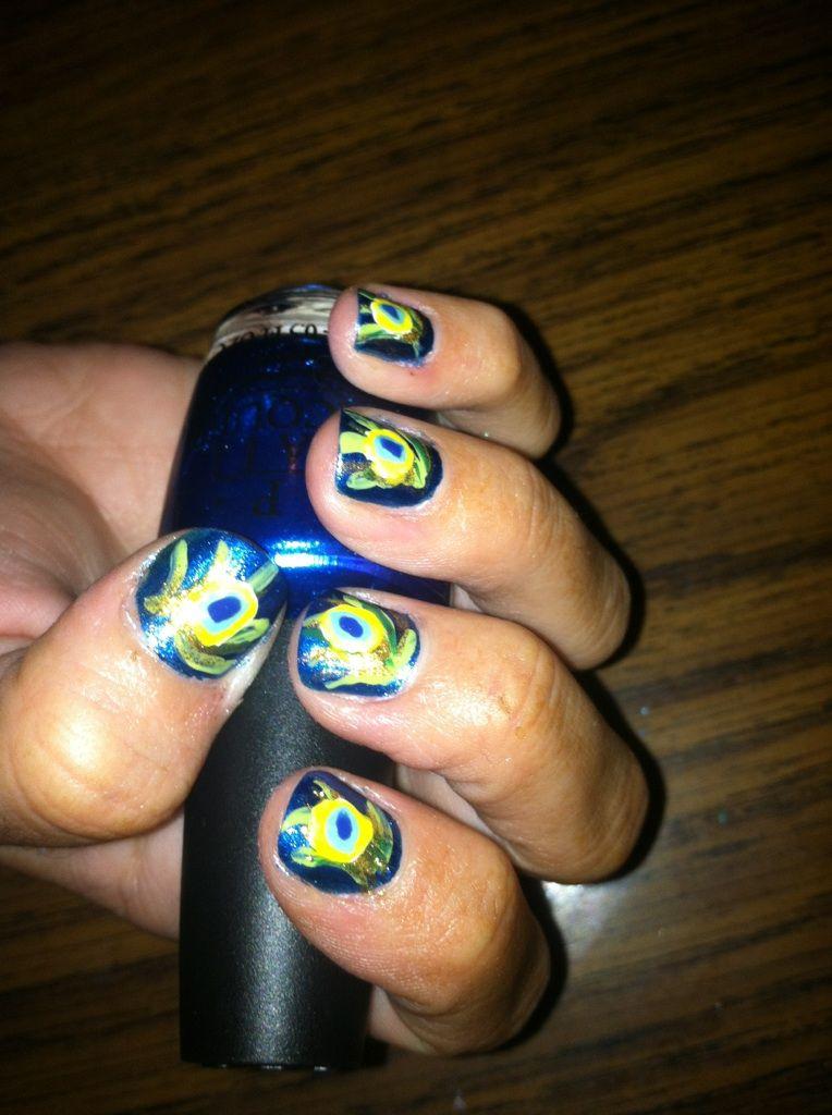 """Sparkley Peacock"" nails."