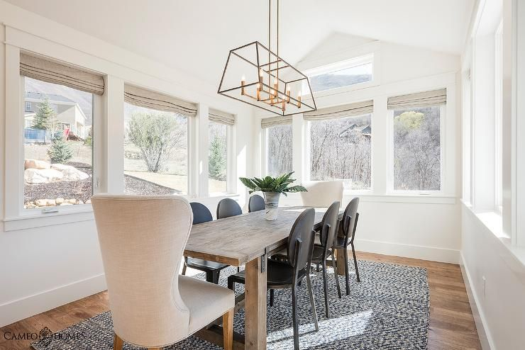 Sun Filled Dining Room Features Vaulted Ceilings Accented