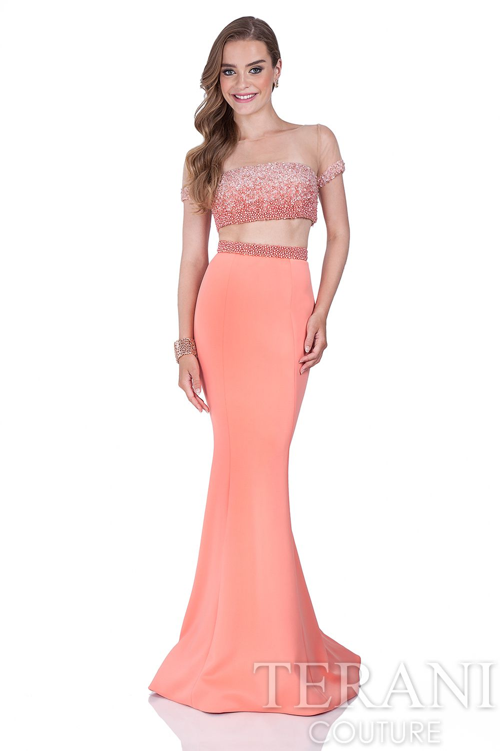 Two piece prom dress with illusion pearl crop top. This prom dress ...