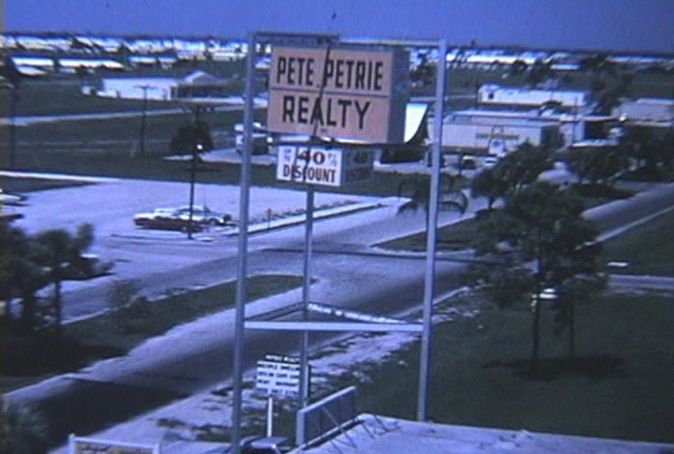 Pete Petrie Realty in Cape Coral 1960. Pete used to wait at the bus stop in town to solicit the new visitors coming to view lots and homes. The visitors were flown in from Travel Guild of America who had to chaperone their visitors so Petrie wouldn't be able to get a hold of them. Marketing 101
