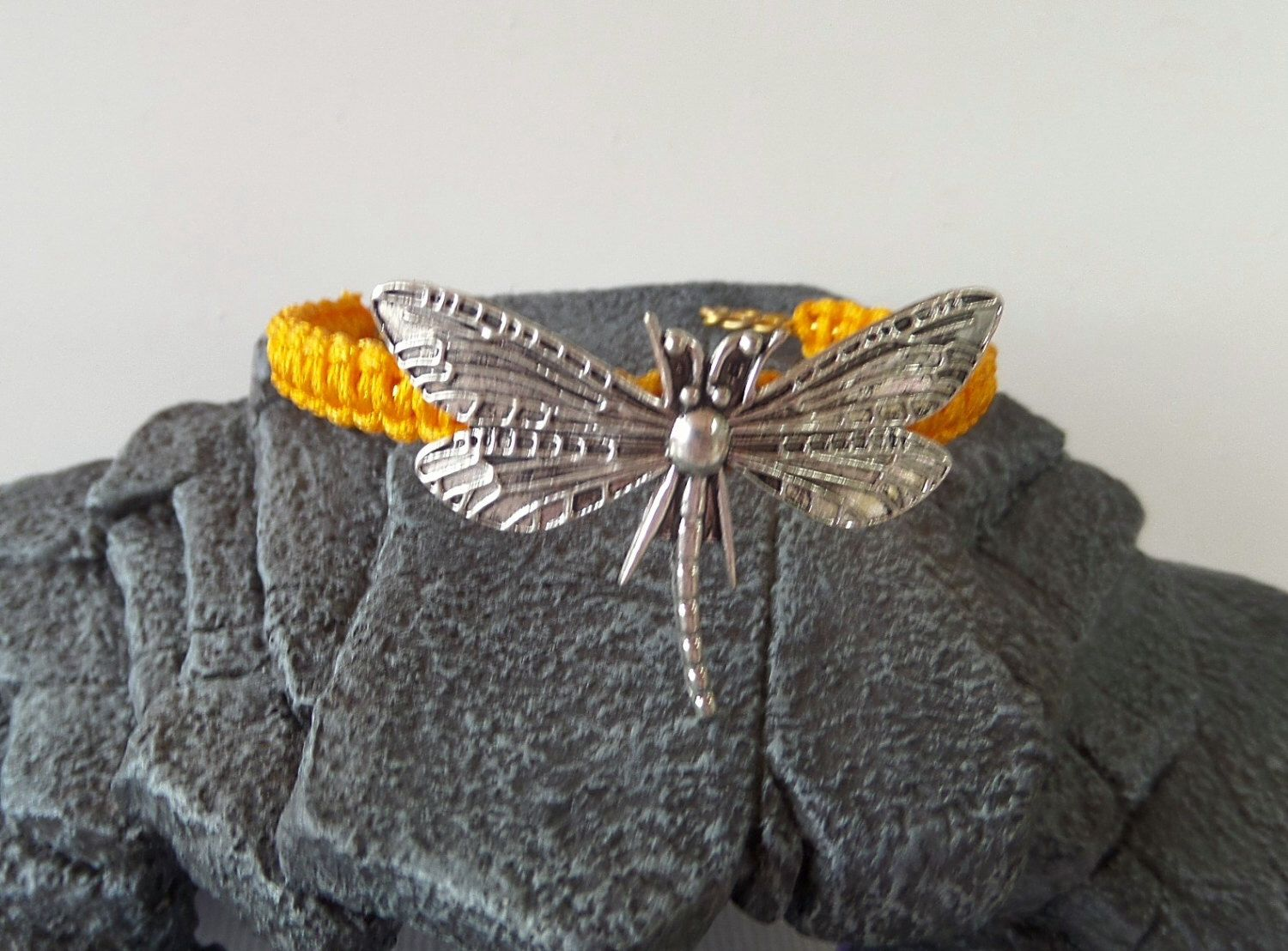 A personal favorite from my Etsy shop https://www.etsy.com/listing/254517484/dragonfly-darkest-yellow-macrame-cuff