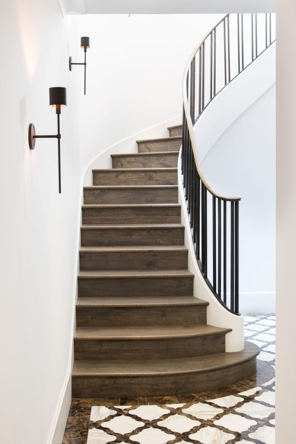 Best Curved Wood Staircase With Iron Rail And Sconce Lights 640 x 480