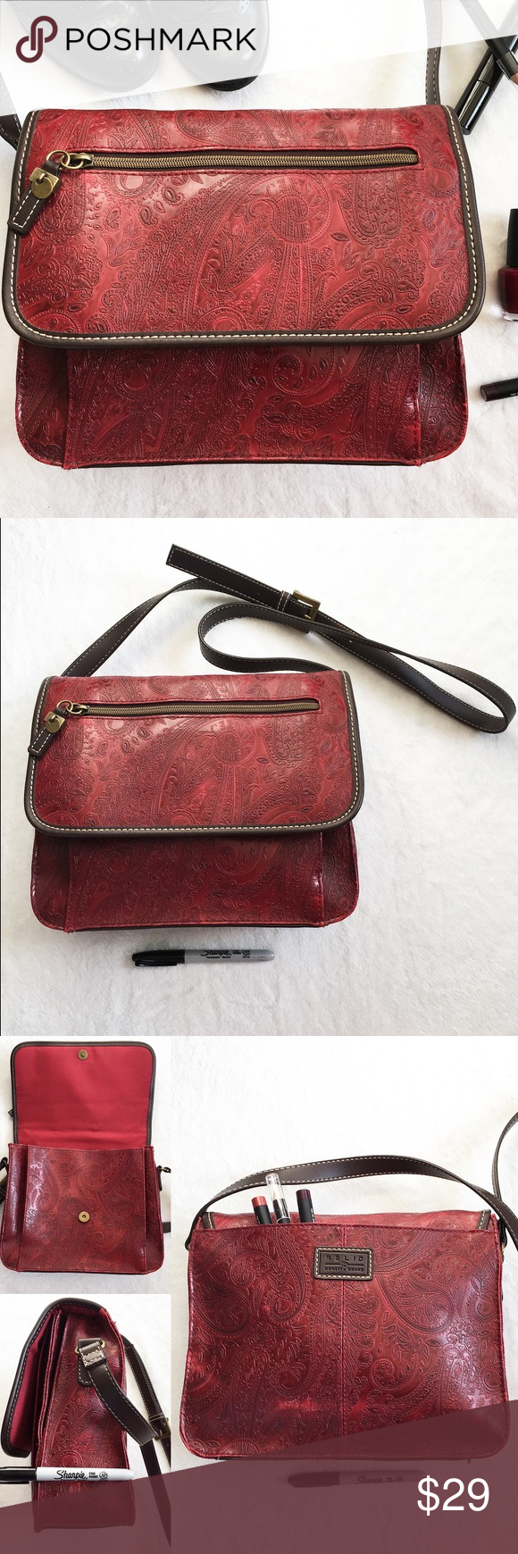 Red Paisley Relic Medium Large Crossbody Purse Bag  Stunning authentic all season Relic Quality Brand bag   Has a deep red / burgundy embossed paisley swirl pattern   Medium size    Over the shoulder / cross body, has an adjustable belt strap    Has a lot of storage compartments. Has on back of the purse, one in the front, three open pockets inside and one zippered pouch in the largest pocket   Has some wearing of color, seen in pictures     Sharpie is to show scale Approximate measurements…