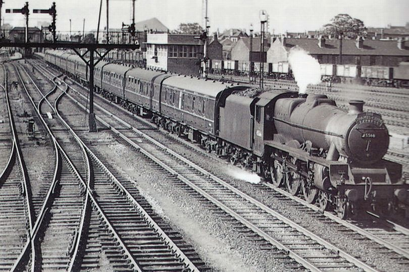 A passenger train approaches toton in 1957 old trains