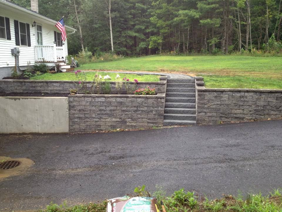 Retaining Wall With Granite Stairs And Flower Bed