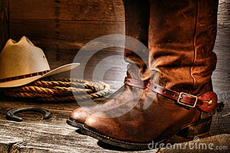 Old Cowboy Antiques | ... hat and rope on an antique wood floor in an old ranch aged wooden barn
