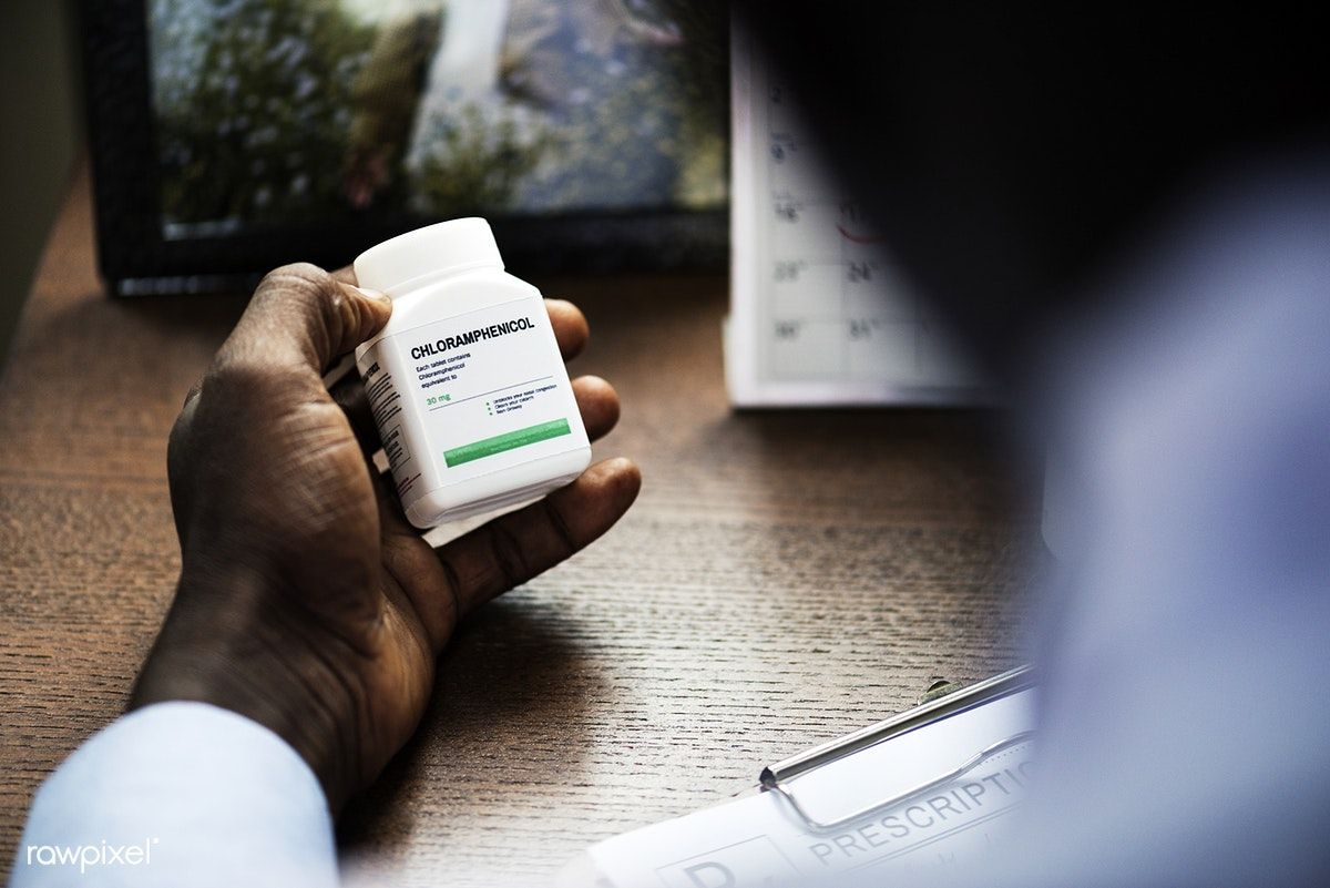 Download premium image of a doctor writing a prescription