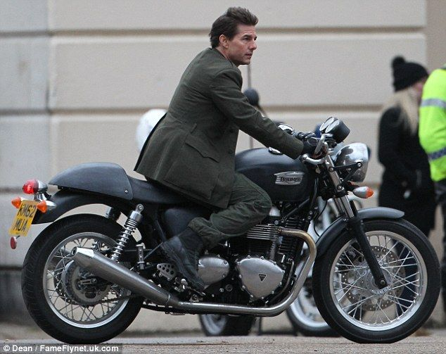 Tom Cruise in Mission Impossible (MI6) riding a Triumph Motorbike