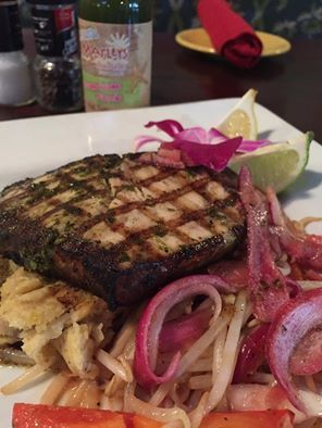 Hungry? Love fish? How about Charleston Swordfish?   A bit about the dish: Wood grilled, whipped green plantains, island pesto, sautéed bean sprouts and pickled red onions...yum!  Marley's Island Grille. Hilton Head, South Carolina.