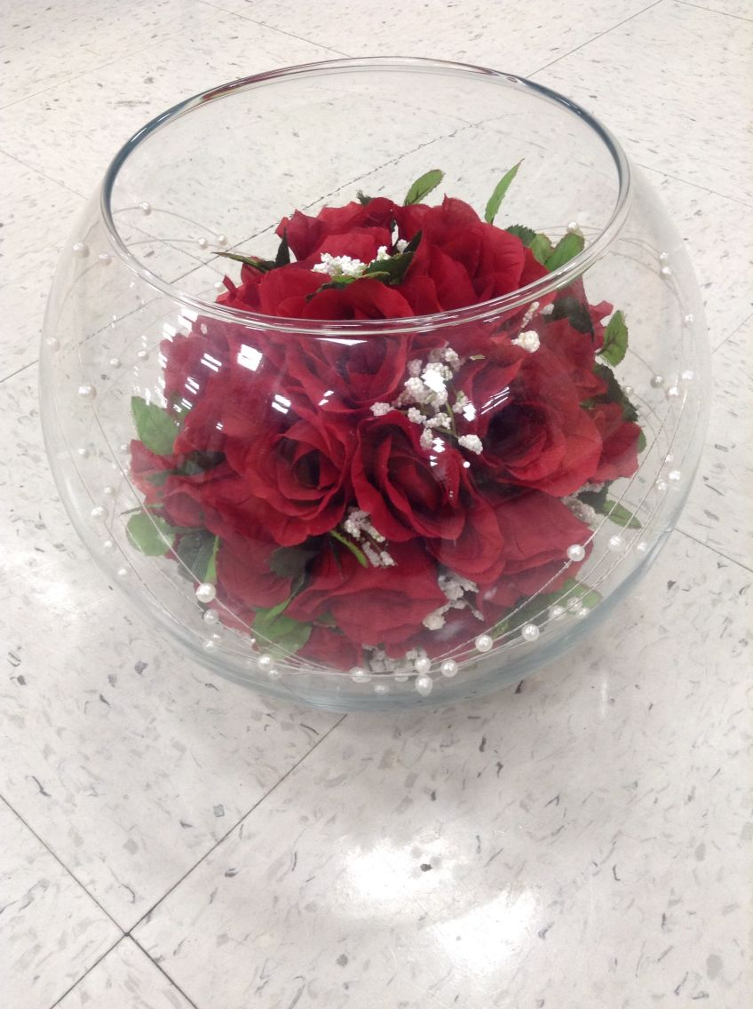 Red Rose Bouquet In Fish Bowl With White Sand And Pearl Strands Arrangement Fish Bowl Centerpiece Wedding Wedding Floral Centerpieces Floral Arrangements