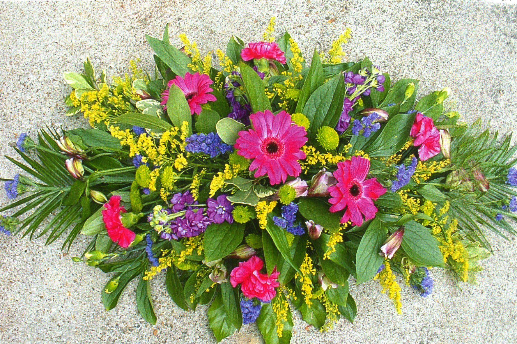 A Double Ended Spray Using A Mixture Of Bright Colourful Flowers Funeral Flowers Casket Sprays Colorful Flowers