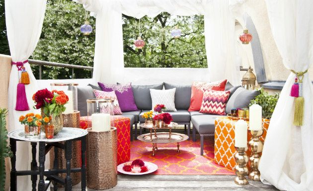 garden gazebo with ottoman and colorful cushions