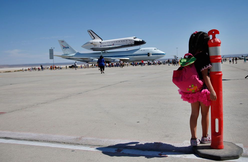 Elizabeth Danirjian, 5, of Santa Clarita, California, looks at Space Shuttle Endeavour atop NASA's Shuttle Carrier Aircraft after it landed at the NASA Dryden Flight Research Center at Edwards Air Force Base, California, on September 20, 2012.