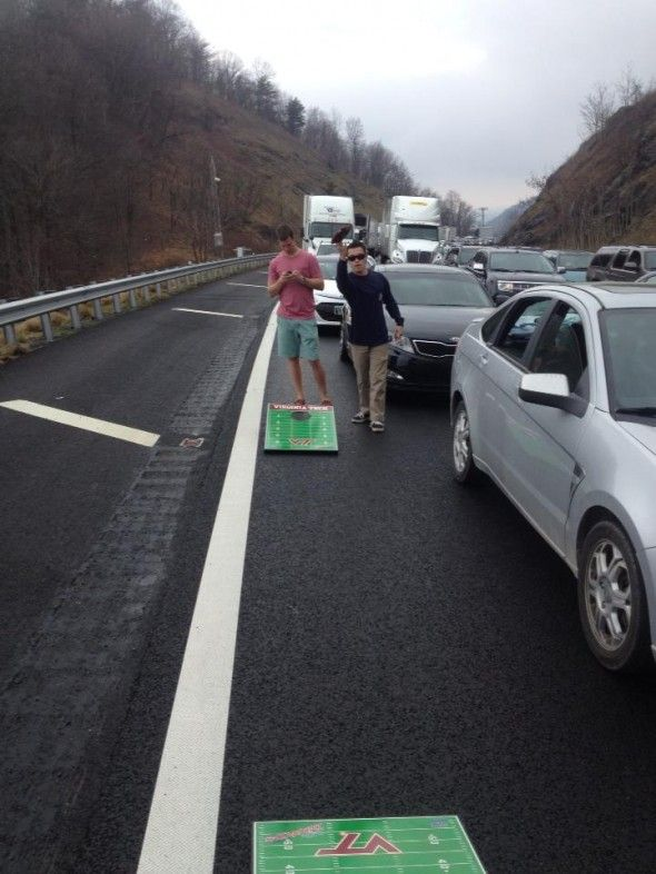 Cornhole in standstill traffic on the way to a game   this