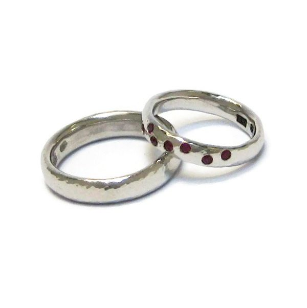 Lovely pair of platinum rings with a high polish and hammered finish